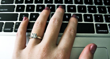 engagement ring hand on keyboard