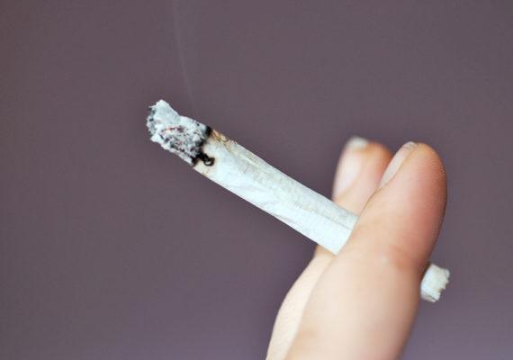 cigarette between two fingers