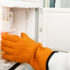 orange glove reaches into biobank freezer