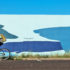 man rides a bicycle past a mural of giant sea animals