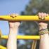 child's hands on the playground
