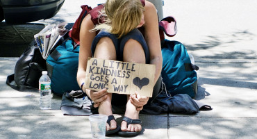 homeless young woman with sign