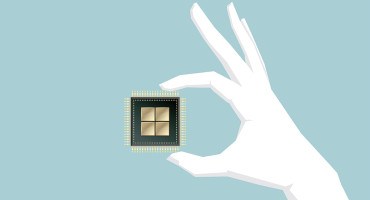 illustration of a hand holding a computer chip