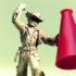 cowboy figurine holds red megaphone