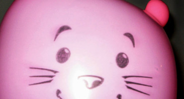 mouse face on pink balloon