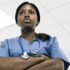black woman wearing scrubs and stethoscope