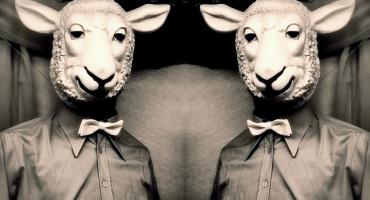 two men wear sheep masks