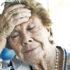 older woman looks sleepy