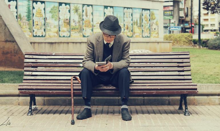 older man reads a book