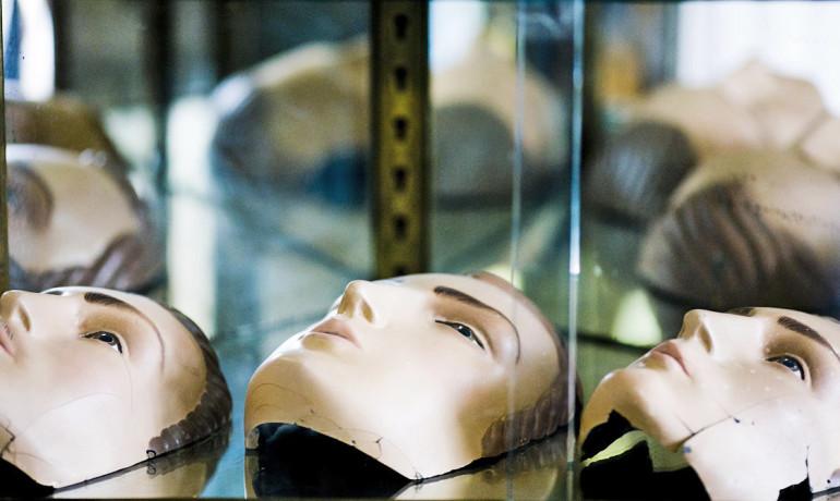 three masks against a mirror