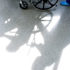 shadow of nurse and patient in wheelchair