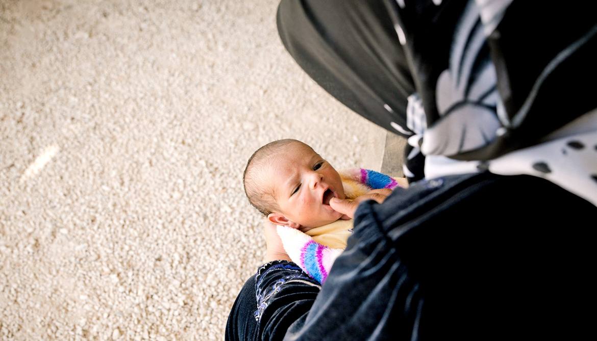 woman and baby in refugee camp