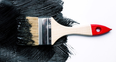 paintbrush and black paint