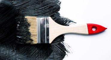 paintbrush and black paint