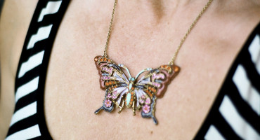 butterfly necklace on woman's chest