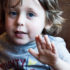 child talking and gesturing