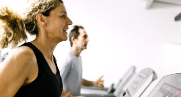couple running on treadmills