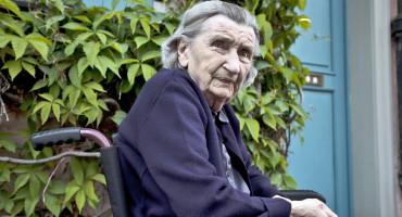 elderly woman in wheelchair outside