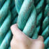 hand holds green rope