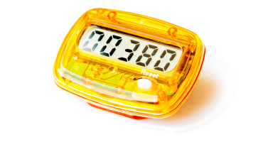 yellow pedometer measures walking