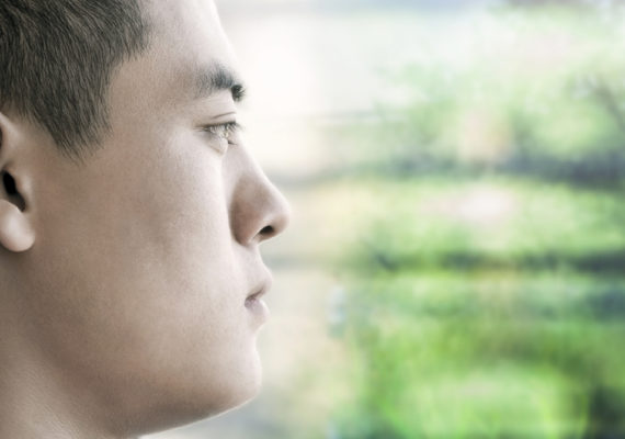 Chinese man looks out window