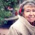 smiling older woman in beige coat