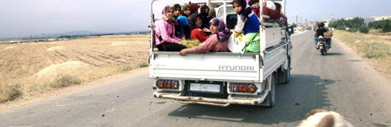 Above, refugees on the road to the Turkish border in Idlib Provence, Syria, in June 2012. (Credit: Dona_Bozzi / Shutterstock.com)