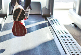 sneakers of runner on treadmill