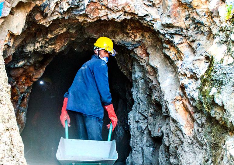 man enters tungsten mine in Rwanda