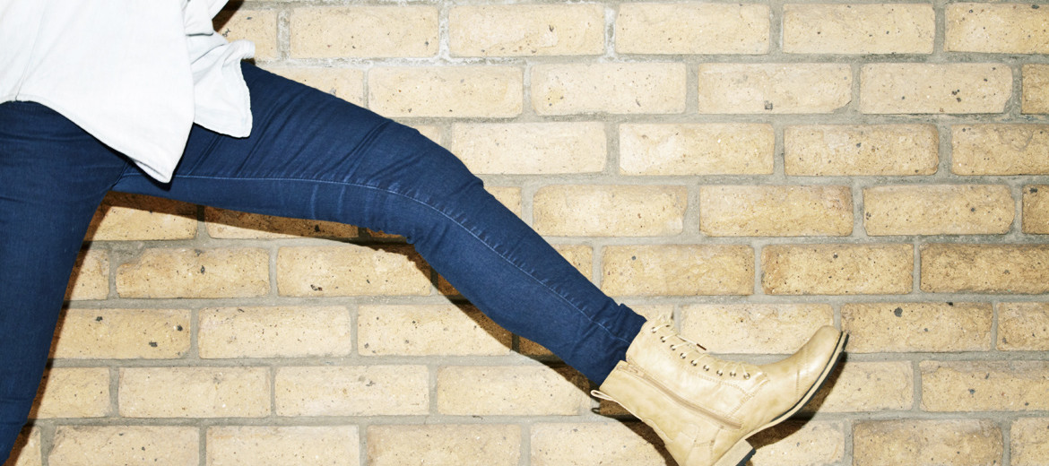 woman wearing jeans leaps