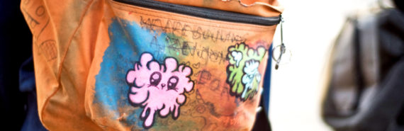 drawing on orange backpack