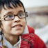 preschool boy with glasses smiles