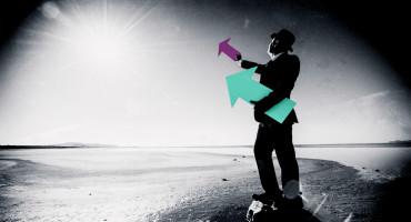 businessman holds arrows