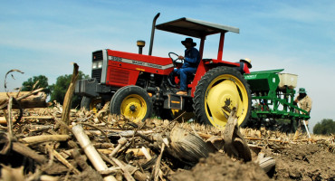 corn residue on field with tractor