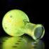 glowing green polymer in flask