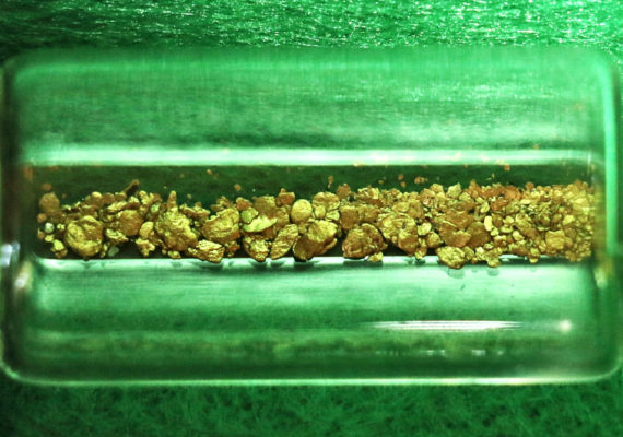 gold bits in green container
