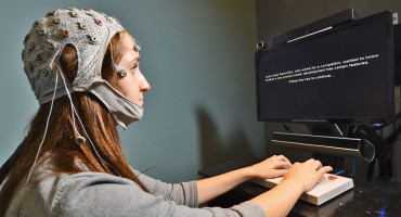 woman has brain activity measured