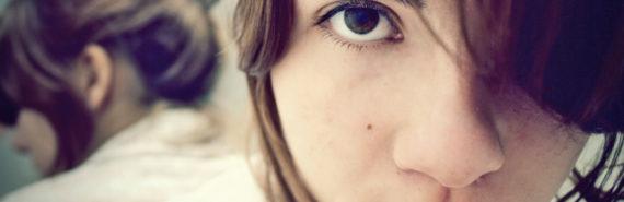 woman stares into camera