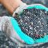 gloved hands hold nitrogen fertilizer