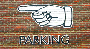 parking sign on brick wall
