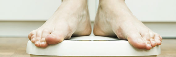 feet on bathroom scale