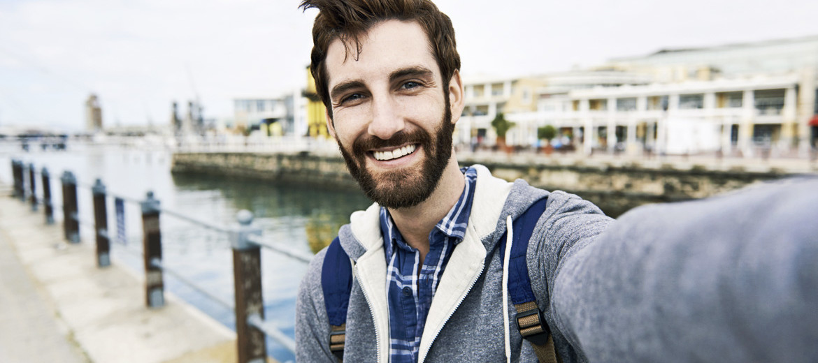 guy takes selfie with smartphone