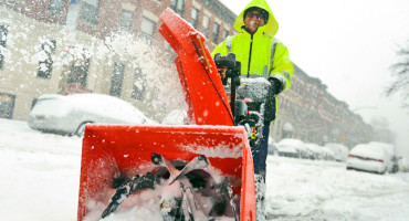 man uses snowblower in Boston