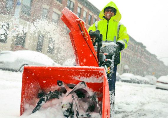 man uses snowblower in Boston