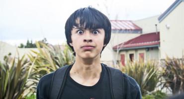 teen boy looks horrified