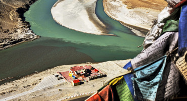 Tibetan plateau rivers with prayer flags