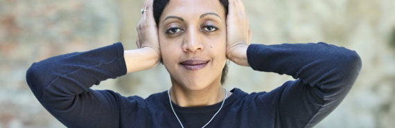 woman covers ears with hands - tinnitus