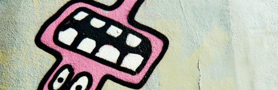 street art head with big teeth