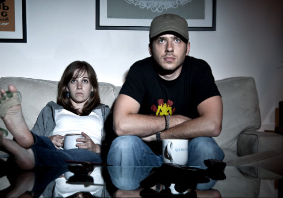 woman and man watch tv