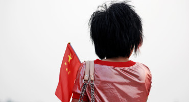 woman holds chinese flag